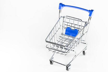 Shopping baskets on a white background. Macro shot