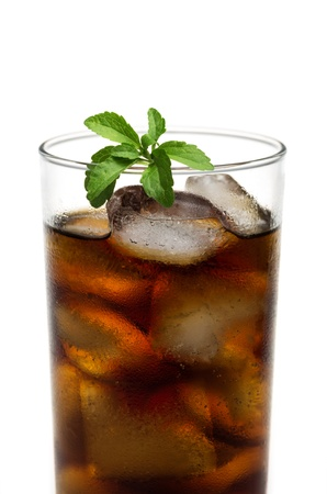 cola in a glass with stevia leaves photo