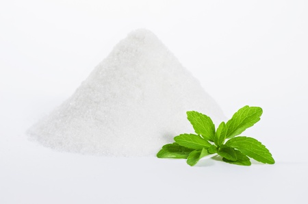 stevia leaves with a pile of sugar Stock Photo