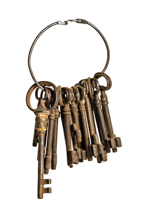 antique keys on a ring isolated on a white background photo