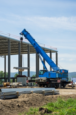 new site: construction site with blue mobile crane