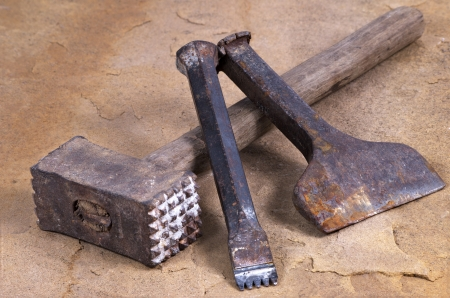 stone work: a hammer with two chisels Stock Photo