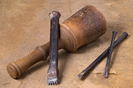 wood stone: a mallet with three chisels Stock Photo