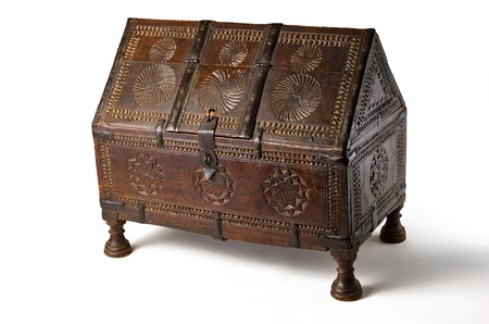 antique wooden chest with carvings on a white background photo