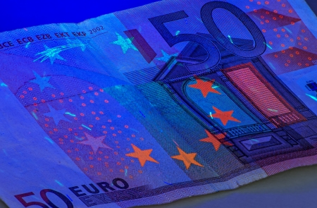 ultraviolet: Fifty Euro under ultraviolet light Stock Photo