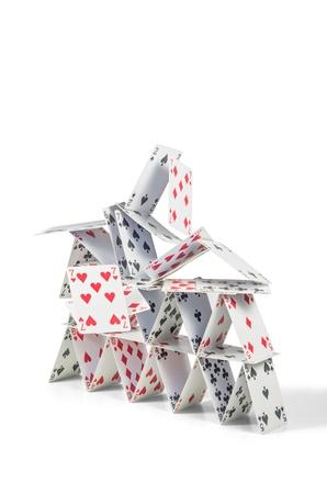 instortende kaartenhuis Stockfoto