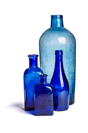 glass vase: Composition of old blue bottles