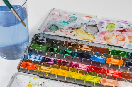 painter palette: watercolors with brush and water glass Stock Photo