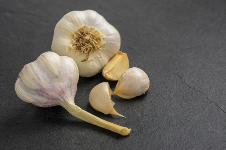 garlic on slate plate photo