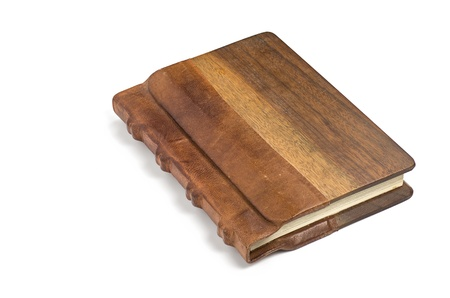 books on a wooden surface: precious book with a noble leather and wooden cover