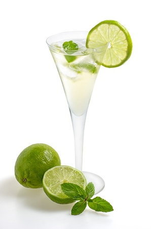 Drink with lime and mint in a champagne glass photo