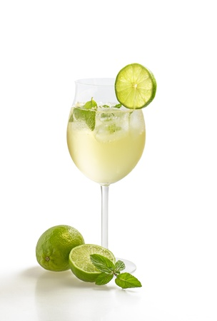 aperitif: Drink with lime and mint in a wine glass Stock Photo