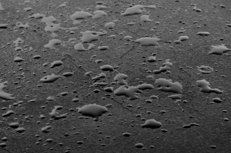 oiled: Macro shot of a slate plate with water drops Stock Photo