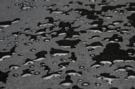 Macro shot of a slate plate with water drops photo