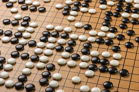 board game: stones on a Go board Stock Photo