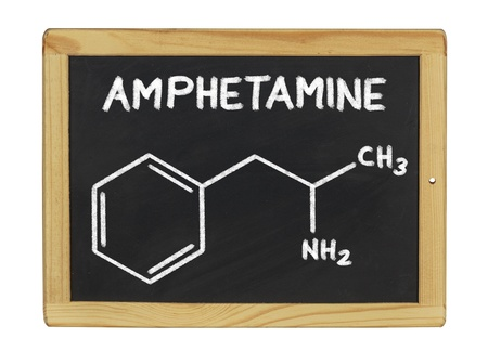 amphetamine: chemical formula of amphetamine on a blackboard