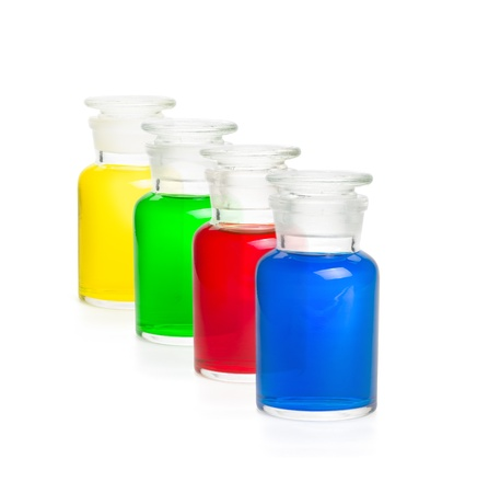 Four laboratory bottles filled with colorful liquids photo