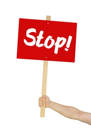 boycott: Person holding a sign saying Stop