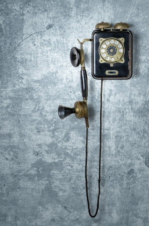antique telephone on a grungy blue wall photo