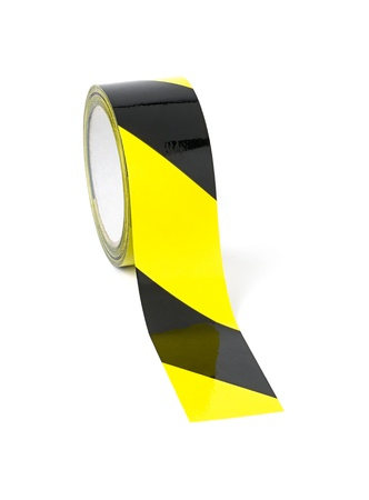 Roll of yellow and black caution tape Stock Photo - 18373325