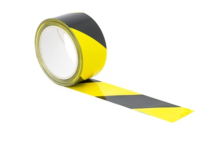Roll of yellow and black caution tape photo