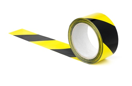 hazard tape: Roll of yellow and black caution tape Stock Photo
