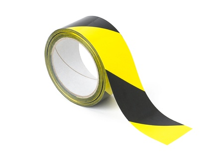restrictions: Roll of yellow and black caution tape Stock Photo