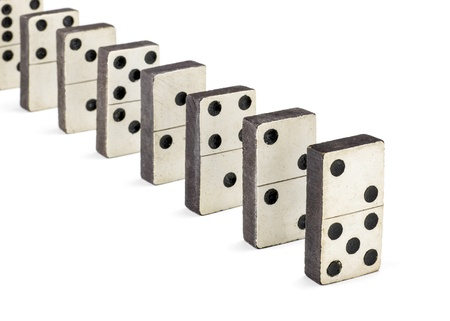 cause: row of old dominoes  Stock Photo