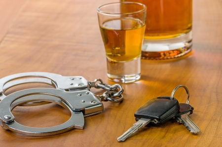 dui: Shot glass with car keys and handcuffs