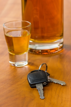drinking driving: Shot glass with car keys Stock Photo