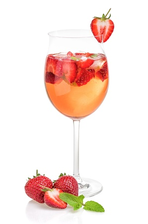 Drink with strawberries and mint in a wine glass photo