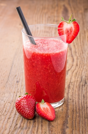 Strawberry smoothie on a wooden table photo