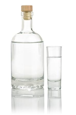 vodka bottle: Liquor bottle with a full shot glass Stock Photo