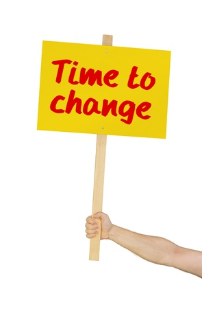 protest signs: Person holding a sign saying Time to change