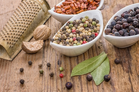 Various spices on a wooden background photo