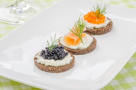 amuse: Canapes with salmon and caviar