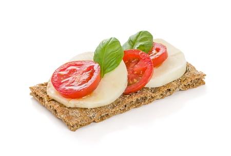 crispbread: Pane croccante con pomodoro e mozzarella Archivio Fotografico