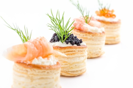 Pastries with salmon, caviar and shrimp photo