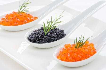 caviar: Red and black caviar on porcelain spoons