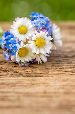 Bouquet with daisies and forget-me-not photo