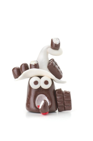 Handmade modeling clay figure with chocolate photo
