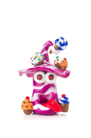 Handmade modeling clay figure with sweets photo