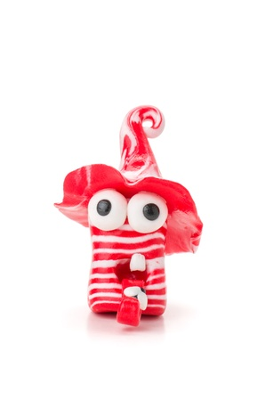 Handmade modeling clay figure with red and white stripes photo
