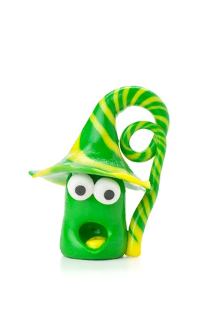 clay modeling: Handmade modeling clay figure with green and yellow stripes Stock Photo