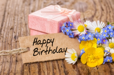 buttercup flower: Birthday gift box with flowers and card Stock Photo