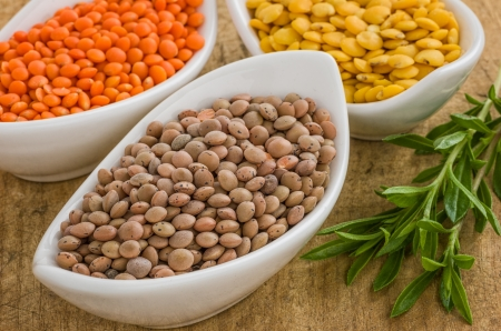 Different types of lentils in bowls photo