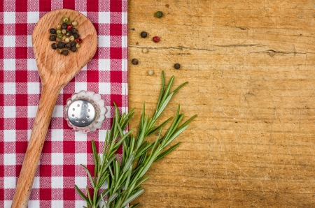 dishcloth: Rustic wooden background with checkered tablecloth and wooden spoon