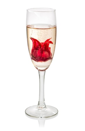 Champagne cocktail with hibiscus flower photo