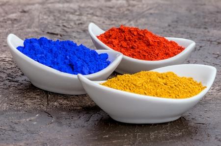 Vibrant color pigments  in porcelain bowls  Stock Photo