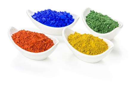 pigments: Vibrant color pigments in porcelain bowls